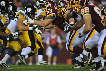 LANDOVER, MD - AUGUST 12:  Will Montgomery #63 of the Washington Redskins defends against the Pittsburgh Steelers  at FedExField on August 12, 2011 in Landover, Maryland. The Redskins defeated the Steelers 16-7. (Photo by Larry French/Getty Images)