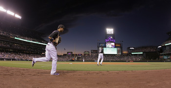 DENVER, CO - AUGUST 16:  Carlos Gonzalez #5 and Dexter Fowler #24 of the Colorado Rockies take the field against the Florida Marlins at Coors Field on August 16, 2011 in Denver, Colorado.  (Photo by Doug Pensinger/Getty Images)