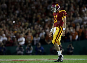 PASADENA, CA - JANUARY 04:  Quaterback Matt Leinart #11 of the USC Trojans walks across the field during the BCS National Championship Rose Bowl Game against the Texas Longhorns at the Rose Bowl on January 4, 2006 in Pasadena, California.  Texas defeated