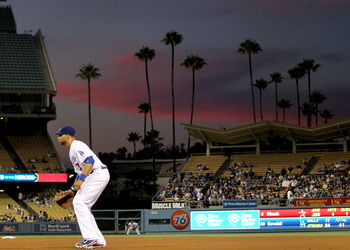 LOS ANGELES, CA - AUGUST 12: First baseman James Loney #7 of the Los Angeles Dodgers sets in the field as the sun sets over the gtame with the Houston Astros on August 12, 2011 at Dodger Stadium in Los Angeles, California.  (Photo by Stephen Dunn/Getty Im