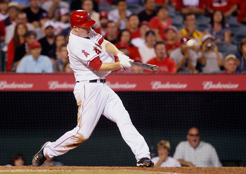 ANAHEIM, CA - AUGUST 18:  Mark Trumbo #44 of the Los Angeles Angels of Anaheim hits the game winning walk off home run against the Texas Rangers in the ninth inning at Angel Stadium of Anaheim on August 18, 2011 in Anaheim, California. The Angels defeated