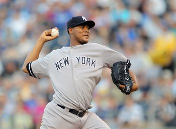 KANSAS CITY, MO - AUGUST 16:  Starting pitcher Ivan Nova #47 of the New York Yankees pitches during the 1st inning of the game against the Kansas City Royals at Kauffman Stadium on August 16, 2011 in Kansas City, Missouri.  (Photo by Jamie Squire/Getty Im