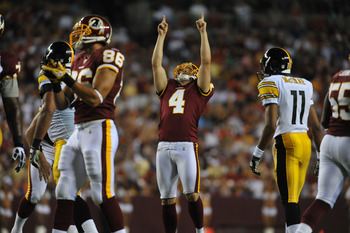 LANDOVER, MD - AUGUST 12:  Graham Gano #4 of the Washington Redskins celebrates a successful field goal against the Pittsburgh Steelers  at FedExField on August 12, 2011 in Landover, Maryland. The Redskins defeated the Steelers 16-7. (Photo by Larry Frenc