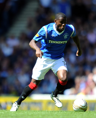 GLASGOW, SCOTLAND - JULY 23:  Maurice Edu of Rangers in action during the Clydesdale Bank Premier League match between Rangers and Hearts at Ibrox Stadium on July 23, 2011 in Glasgow, Scotland.  (Photo by Chris Brunskill/Getty Images)