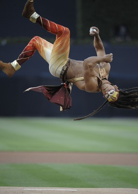 SAN DIEGO, CA - JUNE 27: A performer from the Cirque du Soleil does a flip as he throws out the first pitch before a game between the San Diego Padres and the Kansas City Royals at Petco Park on June 27, 2011 in San Diego, California.  (Photo by Denis Por