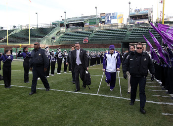 CHICAGO - NOVEMBER 20: Head coach Pat Fitzgerald of the Northwestern Wildcats (center) and injured quarterback Dan Persa enter the field before a game against the Illinois Fighting Illini to be played at Wrigley Field on November 20, 2010 in Chicago, Illi