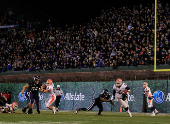 CHICAGO, IL - NOVEMBER 20: Mikel Leshoure #5 of the Illinois Fighting Illini breaks a tackle attempt by Jared Carpenter #27 of the Northwestern Wildcats on his way to a 330 yard rushing performance during a game played at Wrigley Field on November 20, 201
