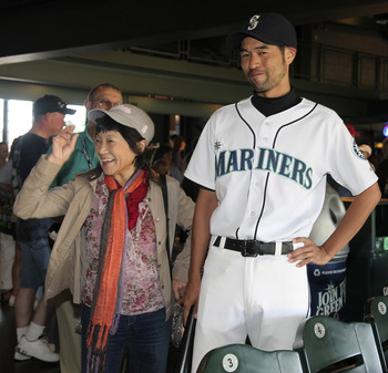 SEATTLE - AUGUST 03:  Kenta Imamura, an Ichiro Suzuki impersonator, poses for a picture with a fan prior to the game between the Seattle Mariners and the Oakland Athletics at Safeco Field on August 3, 2011 in Seattle, Washington. (Photo by Otto Greule Jr/