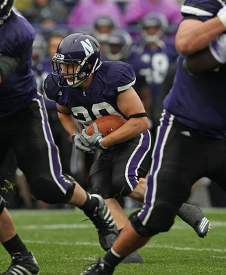 EVANSTON, IL - OCTOBER 23: Mike Trumpy #29 of the Northwestern Wildcats runs against the Michigan State Spartans at Ryan Field on October 23, 2010 in Evanston, Illinois. Michigan State defeated Northwestern 35-27. (Photo by Jonathan Daniel/Getty Images)