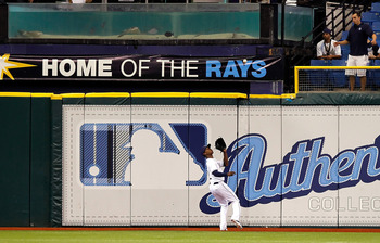 ST. PETERSBURG, FL - AUGUST 03:  Outfielder B.J. Upton #2 of the Tampa Bay Rays catches a fly ball against the Toronto Blue Jays during the game at Tropicana Field on August 3, 2011 in St. Petersburg, Florida.  (Photo by J. Meric/Getty Images)