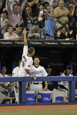 TORONTO, CANADA - AUGUST 10:  Brett Lawrie #13 of the Toronto Blue Jays waves to the crowd after hitting a grand slam home run during MLB game action against the Oakland Athletics August 10, 2011 at Rogers Centre in Toronto, Ontario, Canada. (Photo by Bra
