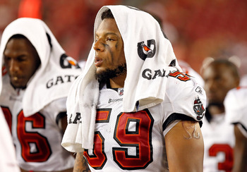 TAMPA, FL - AUGUST 18:  Linebacker Mason Foster #59 of the Tampa Bay Buccaneers watches his team from the bench against the New England Patriots during a preseason game at Raymond James Stadium on August 18, 2011 in Tampa, Florida.  (Photo by J. Meric/Get