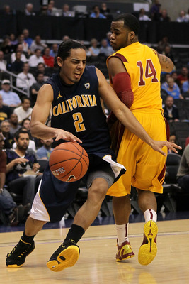 LOS ANGELES, CA - MARCH 10:  Jorge Gutierrez #2 of the California Golden Bears drives by Donte Smith #14 of the USC Trojans in the first half in the quarterfinals of the 2011 Pacific Life Pac-10 Men's Basketball Tournament at Staples Center on March 10, 2