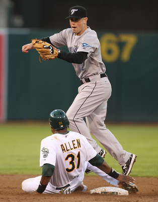OAKLAND, CA - AUGUST 18:  Brandon Allen #31 of the Oakland Athletics slides into second as Aaron Hill #2 of the Toronto Blue Jays tags him out on a fielders choice by Kurt Suzuki at O.co Coliseum on August 18, 2011 in Oakland, California.  (Photo by Jed J