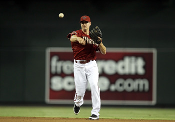 PHOENIX, AZ - JULY 20:  Infielder Kelly Johnson #2 of the Arizona Diamondbacks fields a ground ball out against the Milwaukee Brewers during the Major League Baseball game at Chase Field on July 20, 2011 in Phoenix, Arizona.  The Brewers defeated the Diam
