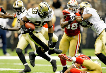 NEW ORLEANS, LA - AUGUST 12: Mark Ingram # 28 of the New Orleans Saints runs into the end zone for a touchdown against the San Francisco 49ers during their pre season game at Louisiana Superdome on August 12, 2011 in New Orleans, Louisiana.  (Photo by Sea