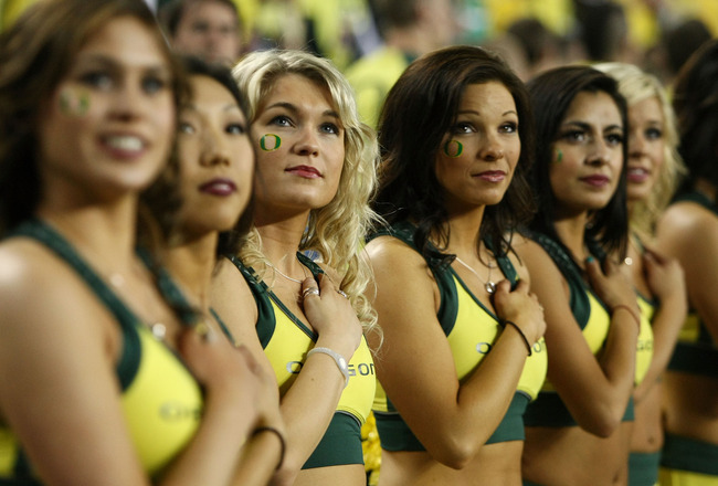 GLENDALE, AZ - JANUARY 10:  The Oregon Ducks cheerleaders perform before taking on the Auburn Tigers in the Tostitos BCS National Championship Game at University of Phoenix Stadium on January 10, 2011 in Glendale, Arizona.  (Photo by Jonathan Ferrey/Getty