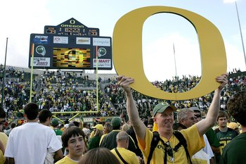 EUGENE, OR - SEPTEMBER 16: Fans celebrate after the Oregon Ducks defeated the Oklahoma Sooners 34-33 on September 16, 2006 at Autzen Stadium in Eugene, Oregon. (Photo by Jonathan Ferrey/Getty Images)
