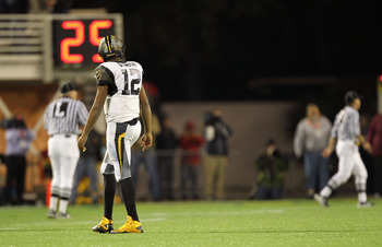 ORLANDO, FL - DECEMBER 28:  Geno Smith #12 of the West Virginia Mountineers walks off the field after an interception during the Champs Sports Bowl against the North Carolina State Wolfpack at Florida Citrus Bowl Stadium on December 28, 2010 in Orlando, F
