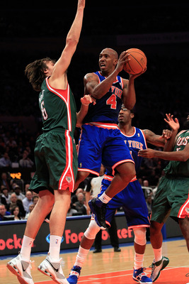 NEW YORK, NY - FEBRUARY 23:  Chauncey Billups # 4 of the New York Knicks goes up for a basket against Andrew Bogut #6 of the Milwaukee Bucks at Madison Square Garden on February 23, 2011 in New York City. NOTE TO USER: User expressly acknowledges and agre