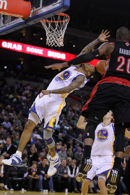 OAKLAND, CA - MARCH 25: Monta Ellis #8 of the Golden State Warriors is fouled by Leandro Barbosa #20 of the Toronto Raptors at Oracle Arena on March 25, 2011 in Oakland, California. NOTE TO USER: User expressly acknowledges and agrees that, by downloading