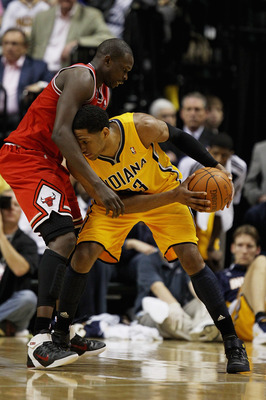 INDIANAPOLIS, IN - APRIL 23: Danny Granger #33 of the Indiana Pacers tries to move against Loul Deng #9 of the Chicago Bulls in Game Four of the Eastern Conference Quarterfinals in the 2011 NBA Playoffs at Conseco Fieldhouse on April 23, 2011 in Indianapo