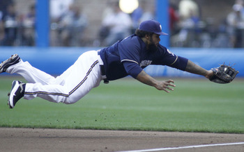 MILWAUKEE, WI - AUGUST 16: Prince Fielder #28 of the Milwaukee Brewers makes a diving catch for the out against Andre Ethier #16 of the Los Angeles Dodgers in the first inning at a Major League Baseball game at Miller Park Stadium on August 16, 2011 in Mi