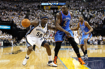 MEMPHIS, TN - MAY 13:  Zach Randolph #50 of the Memphis Grizzlies steps back against Kendrick Perkins #5 of the Oklahoma City Thunder in Game Six of the Western Conference Semifinals in the 2011 NBA Playoffs at FedExForum on May 13, 2011 in Memphis, Tenne
