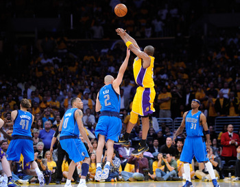 LOS ANGELES, CA - MAY 02:  Kobe Bryant #24 of the Los Angeles Lakers misses a three-pointer at the buzzer over Jason Kidd #2 of the Dallas Mavericks as the Mavericks win 96-94 in Game One of the Western Conference Semifinals in the 2011 NBA Playoffs at St