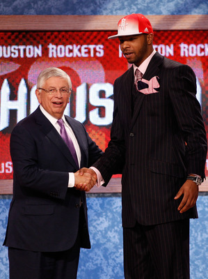 NEWARK, NJ - JUNE 23:  Marcus Morris from the Kansas Jayhawks greets NBA Commissioner David Stern after he was selected #14 overall by the Houston Rockets during the 2011 NBA Draft at the Prudential Center on June 23, 2011 in Newark, New Jersey.  NOTE TO