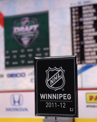 ST PAUL, MN - JUNE 24:  A table plaque marks the spot where the Winnipeg franchise will conduct their draft during day one of the 2011 NHL Entry Draft at Xcel Energy Center on June 24, 2011 in St Paul, Minnesota.  (Photo by Bruce Bennett/Getty Images)