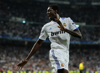 MADRID, SPAIN - APRIL 05:  Emmanuel Adebayor of Real Madrid celebrates scoring his second goal during the UEFA Champions League quarter final first leg match between Real Madrid and Tottenham Hotspur at Estadio Santiago Bernabeu on April 5, 2011 in Madrid