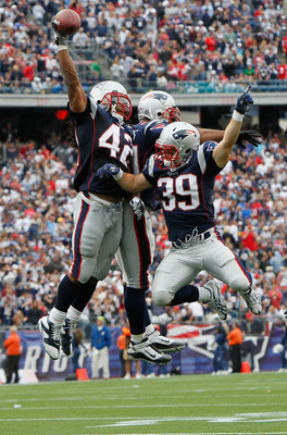 FOXBORO, MA - SEPTEMBER 26: BenJarvus Green-Elllis #42 of the New England Patriots celebrates his touchdown with teammates Sammy Morris #34 and Danny Woodhead #39 in the second half against the Buffalo Bills at Gillette Stadium in the second half on Septe