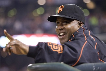 SAN FRANCISCO, CA - SEPTEMBER 21:   San Francisco Giants left fielder Barry Bonds watches the game from the Giants dugout after a press conference earlier in the day announcing the Giants will not bring Barry Bonds back for the Giants 2008 season Septembe