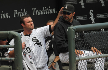 CHICAGO, IL - AUGUST 14: Starting pitcher John Danks #50 of the Chicago White Sox playfully taps manager Ozzie Guillen #13 on the head before a game against the Kansas City Royals at U.S. Cellular Field on August 14, 2011 in Chicago, Illinois. (Photo by J