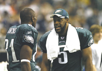 Philadephia Eagles Donovan McNabb talks with wide receiver Terrell Owens after a 59-yard McNabb to Owens touchdown pass    against the Dallas Cowboys on Monday Night Football November 15, 2005 at Texas Stadium.  (Photo by Al Messerschmidt/Getty Images)