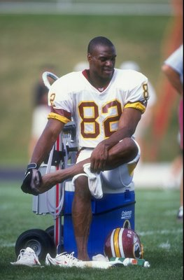 28 Jul 1998:  Wide receiver Michael Westbrook #82 of the Washington Redskins takes a break during the Redskins training camp at Frostburg State University in Frostburg, Maryland. Mandatory Credit: Doug Pensinger  /Allsport