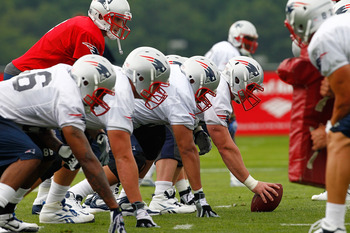 FOXBOROUGH, MA  - JULY 29:  The offensive line of the New England Patriots participates in a session of training camp at Gillette Stadium on July 29, 2011 in Foxborough, Massachusetts.  (Photo by Jim Rogash/Getty Images)
