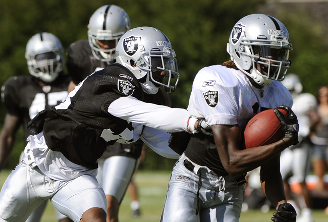 NAPA, CA - AUGUST 5: Denarius Moore #17 of the Oakland Raiders runs away from DeMarcus Van Dyke #38 during practice at the Oakland Raiders training facility on August 5, 2011 in Napa, California. (Photo by Thearon W. Henderson/Getty Images)