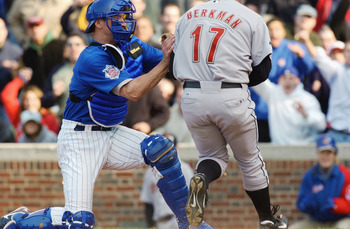 CHICAGO - MAY 31:  Catcher Damian Miller #27 of the Chicago Cubs tags out left fielder Lance Berkman #17 of the Houston Astros at the plate in the 9th inning during the game at Wrigley Field on May 31, 2003 in Chicago, Illinois. The Cubs defeated the Astr