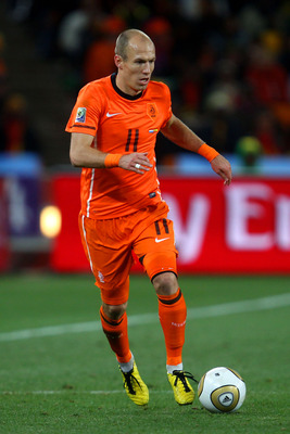 JOHANNESBURG, SOUTH AFRICA - JULY 11:  Arjen Robben of the Netherlands runs with the ball during the 2010 FIFA World Cup South Africa Final match between Netherlands and Spain at Soccer City Stadium on July 11, 2010 in Johannesburg, South Africa.  (Photo