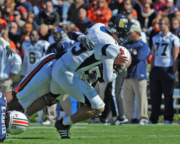 AUBURN, AL - NOVEMBER 06:  Defensive end Corey Lemonier #55 of the Auburn Tigers tackles quarterback B. J. Coleman #19 of  the Chattanooga Mocs November 6, 2010 at Jordan-Hare Stadium in Auburn, Alabama.  (Photo by Al Messerschmidt/Getty Images)