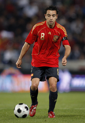 HUELVA, SPAIN - MAY 31:  Xavi Hernandez of Spain controls the ball during the international friendly match between Spain and Peru at the Nuevo Colombino stadium on May 31, 2008 in Huelva, Spain. Spain won the match 2-1.  (Photo by Jasper Juinen/Getty Imag