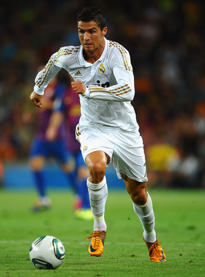 BARCELONA, SPAIN - AUGUST 17:  Cristiano Ronaldo of Real Madrid in action during the Super Cup second leg match between Barcelona and Real Madrid at Nou Camp on August 17, 2011 in Barcelona, Spain.  (Photo by Laurence Griffiths/Getty Images)