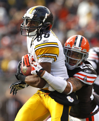 CLEVELAND, OH - JANUARY 02:  Wide receiver Emmanuel Sanders #88 of the Pittsburgh Steelers runs the ball as he is hit by defensive back Joe Haden #23 of the Cleveland Browns at Cleveland Browns Stadium on January 2, 2011 in Cleveland, Ohio.  (Photo by Mat