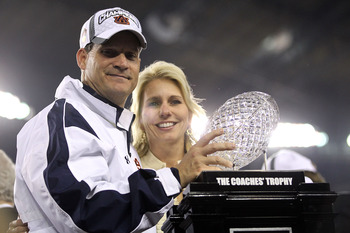 GLENDALE, AZ - JANUARY 10:  Head coach Gene Chizik of the Auburn Tigers celebrates the Tigers 22-19 victory as he holds up the Coaches Trophy after defeating the Oregon Ducks during the Tostitos BCS National Championship Game at University of Phoenix Stad