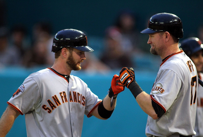 MIAMI GARDENS, FL - AUGUST 13:  Jeff Keppinger #8 of the San Francisco Giants celebrates a home run with teammate Aubrey Huff #17 against the Florida Marlins at Sun Life Stadium on August 13, 2011 in Miami Gardens, Florida.  (Photo by Marc Serota/Getty Im