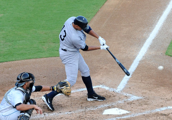 DUNEDIN, FL - AUGUST 12:  Designated hitter Alex Rodriguez of the Tampa Yankees doubles in the third inning against the Dunedin Blue Jays  August 12, 2011 at Florida Auto Exchange Stadium in Dunedin, Florida. Rodriguez played during a rehabilitation assig