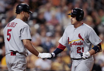 PITTSBURGH - AUGUST 17:  Allen Craig #21 of the St Louis Cardinals is congratulated by teammate Albert Pujols #5 after hitting a solo home run against the Pittsburgh Pirates during the game on August 17, 2011 at PNC Park in Pittsburgh, Pennsylvania.  (Pho