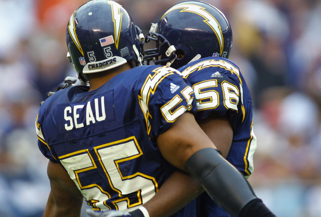 28 Oct 2001:  Junior Seau #55 linebacker for the San Diego Chargers celebrates a play with linebacker Orlando Ruff #56  versus the Buffalo Bills at Qualcomm Stadium in San Diego, California.  The Chargers won 27-24. DIGITAL IMAGE  Mandatory Credit: Stephe